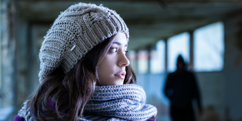 Practicing situational awareness helps a woman walking alone to realize someone is following her.
