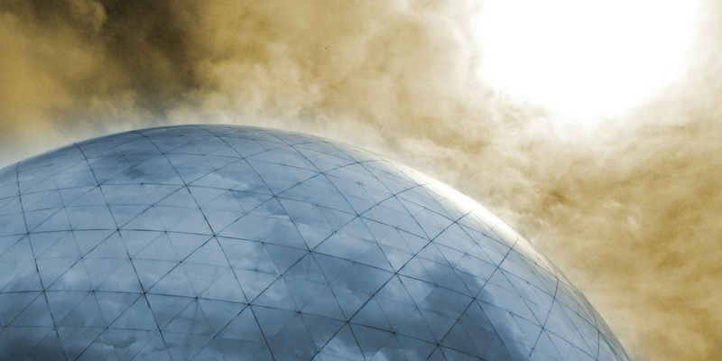 A possible future. A glass dome with harsh sunlight and grey clouds.
